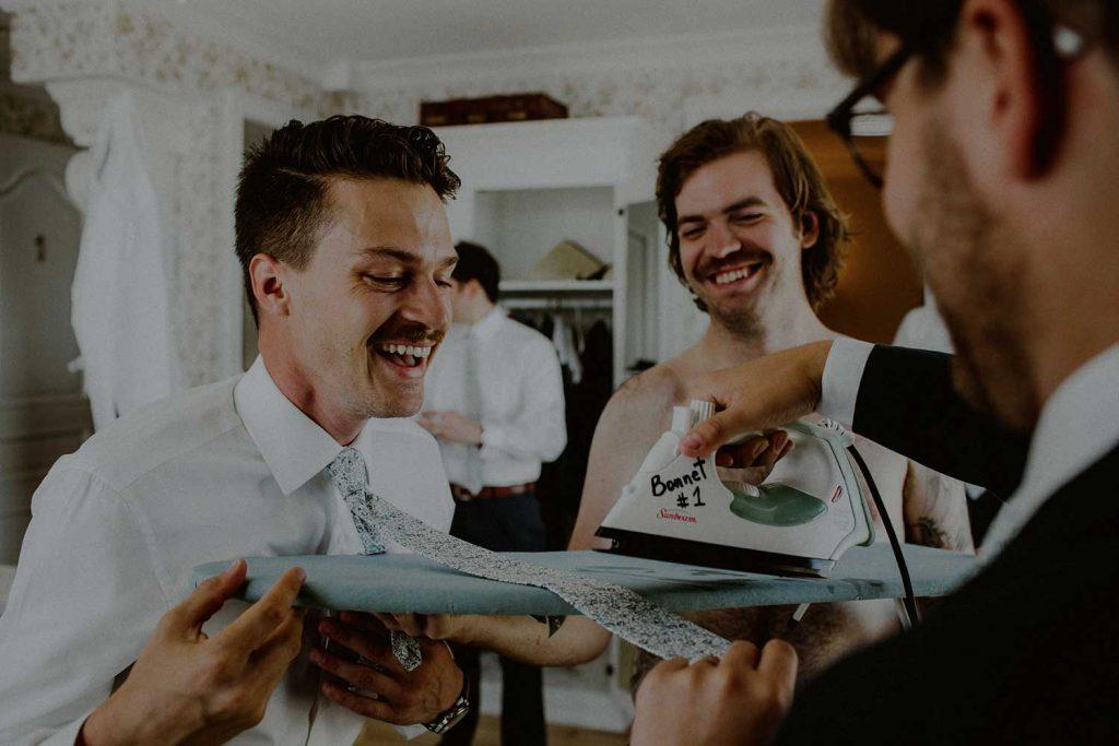 groom and groomsmen getting ready at bonnet island wedding suite