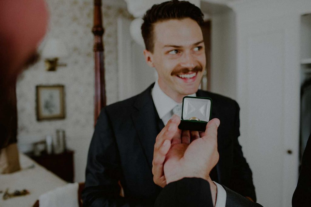 groom gets ready at bonnet island wedding suite