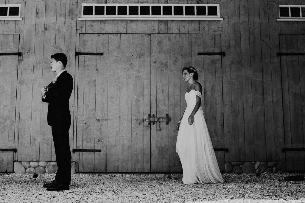 first look in front of barn at bonnet island wedding