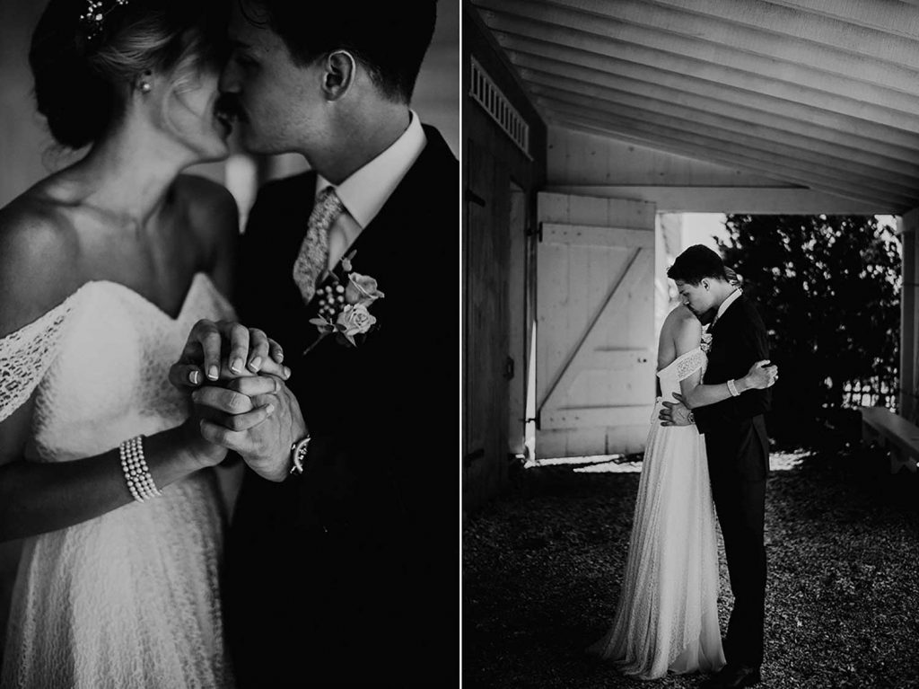 bride and groom emotional portrait in front of barn