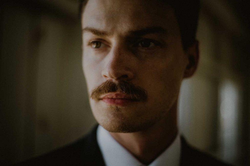 serious portrait of groom