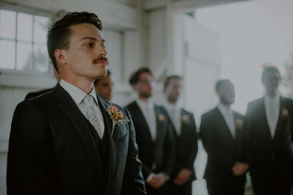 groom awaits bride during ceremony at bonnet island