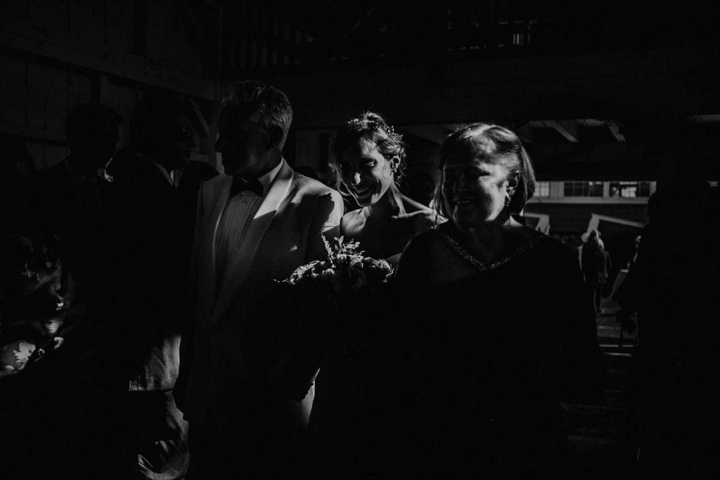dramatic ceremony entrance of bride in black and white