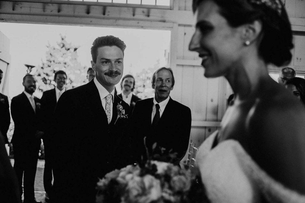 groom sees bride enter wedding ceremony at bonnet island chapel