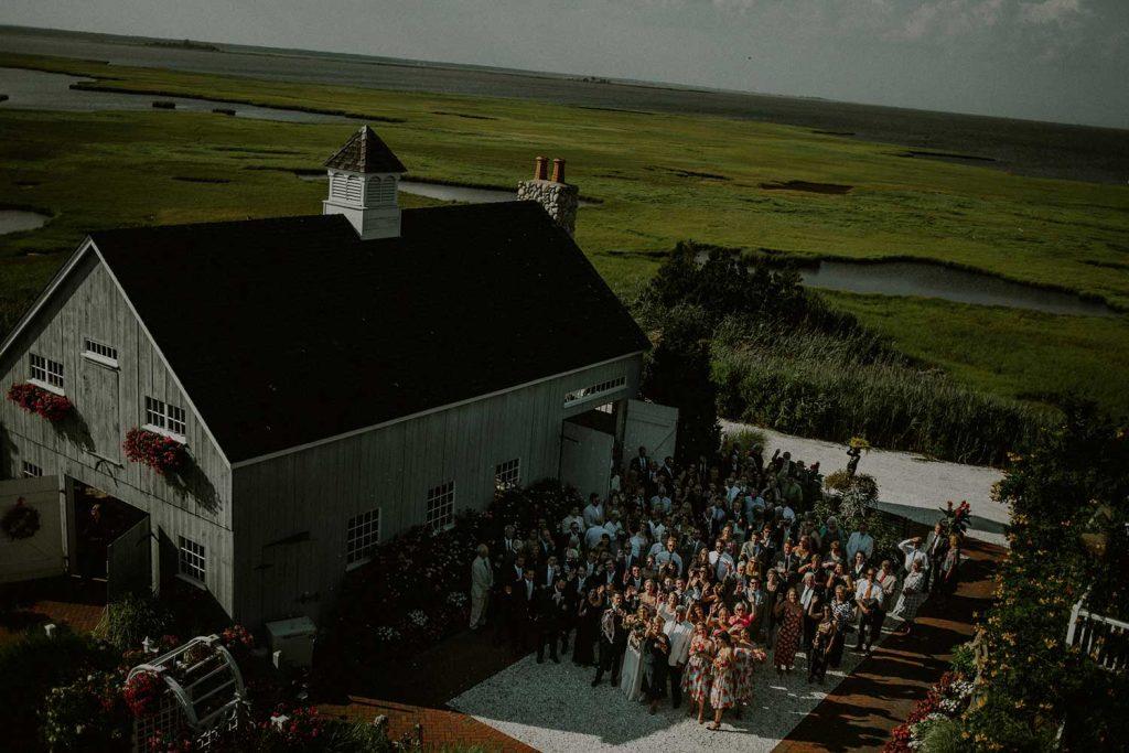 aerial shot of wedding guests next to bonnet island wedding chapel