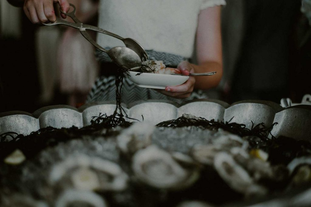 fresh summer seafood served at cocktail hour of bonnet island wedding