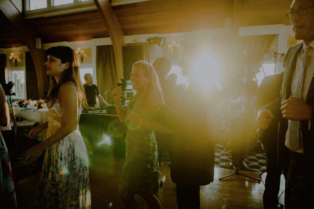 sunset wedding scene on the dance floor
