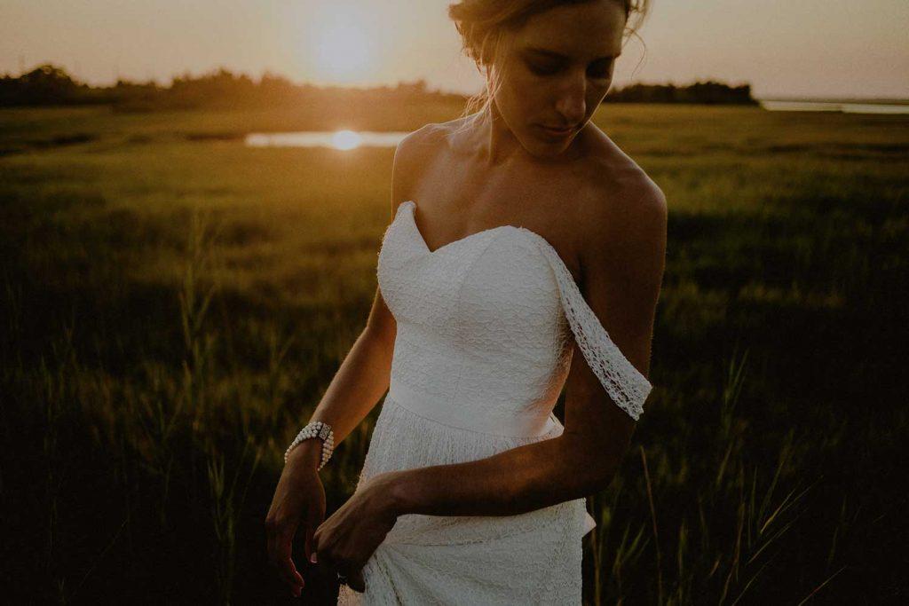 beautiful bride poses for sunset bridal portraits at long beach island wedding