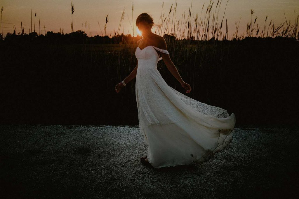 portrait of bride at bonnet island wedding in the marsh at sunset