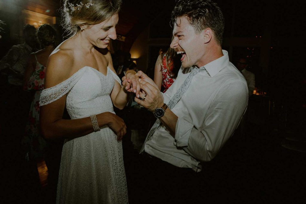 bride and groom enjoy a moment together at their bonnet island wedding reception