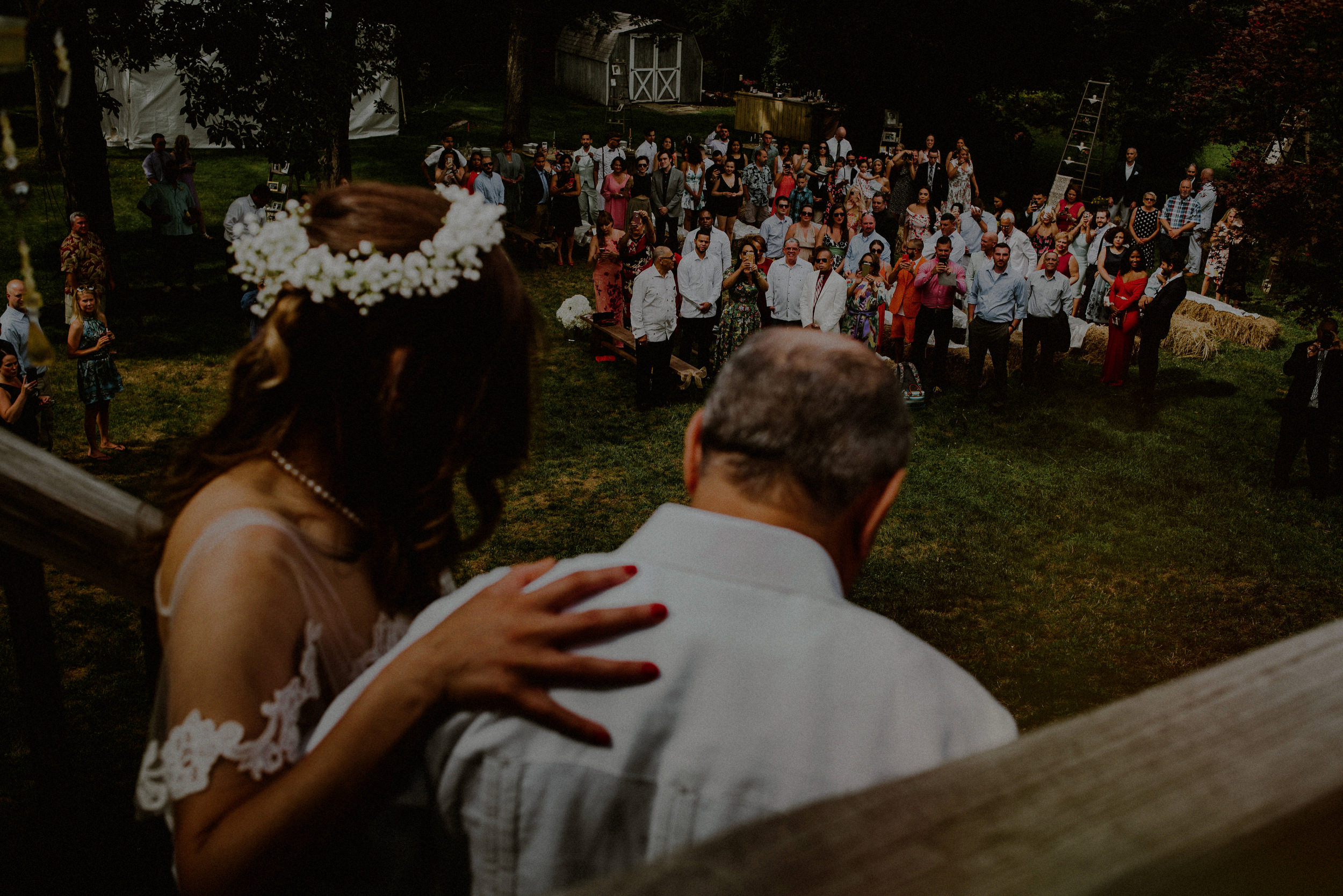 bride and father walking down aisle in backyard wedding
