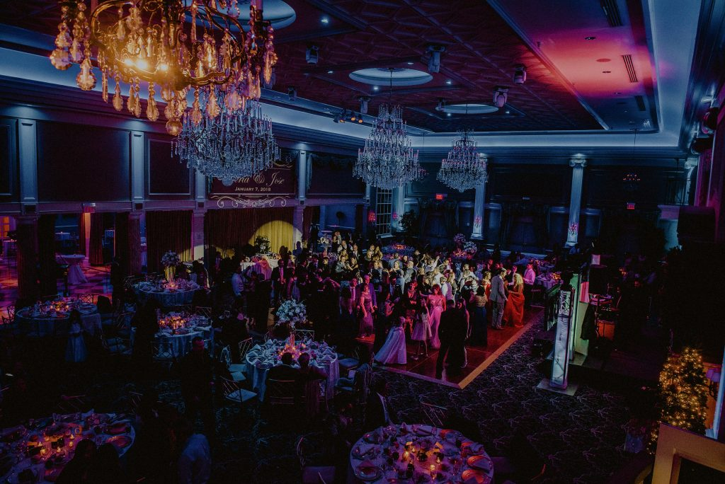 the palace at somerset wedding ballroom with multicolored uplights