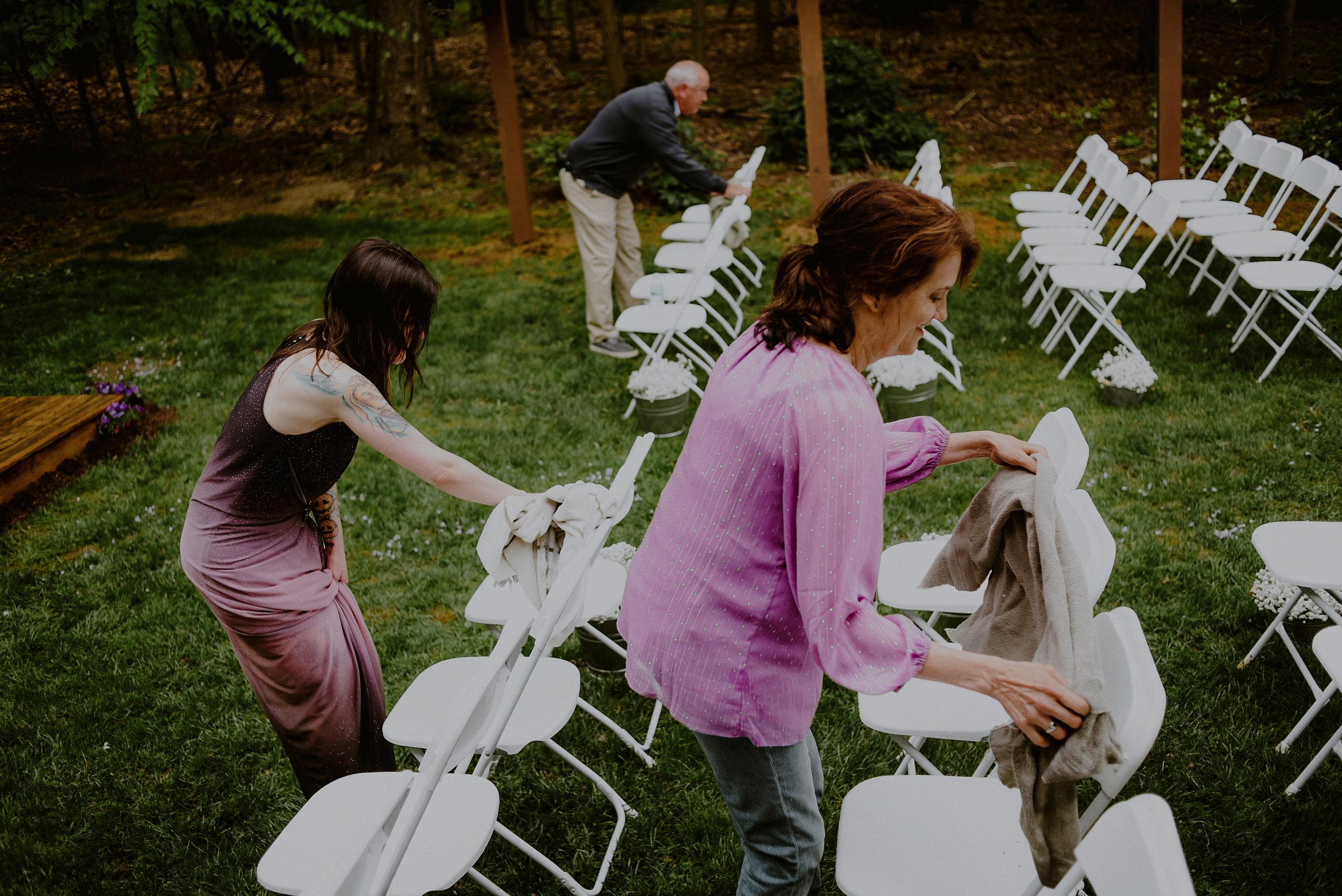 family helps set up diy backyard wedding